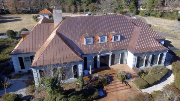 Double lock mechanical standing seam copper metal roofing installation - NC