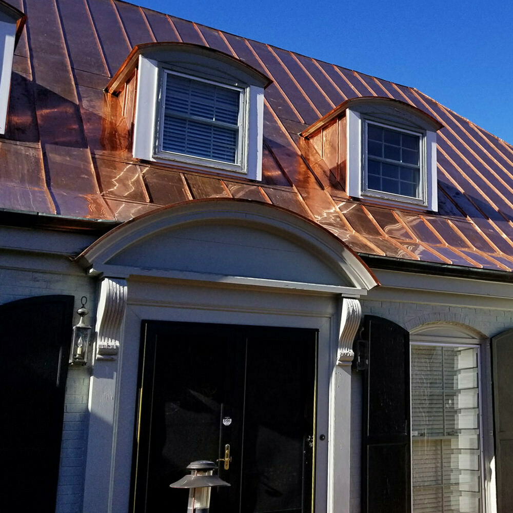 Double lock mechanical standing seam copper metal roofing installation - Featured - NC