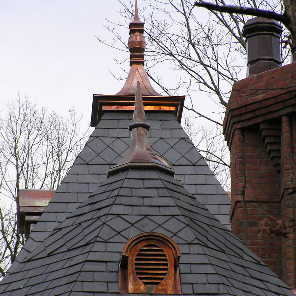 Vermont black slate roofing installation - copper curved panel detail with final and dormers